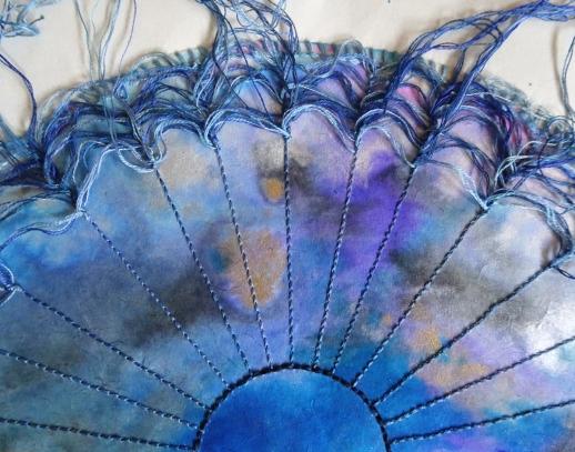 stitched blue tondo undone close up s